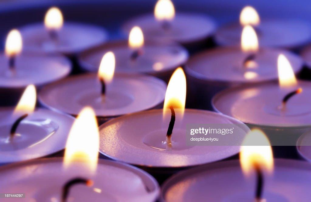 Burning violett candles background : Stock Photo