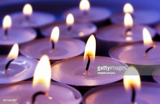 burning violett candles background - candle stock pictures, royalty-free photos & images