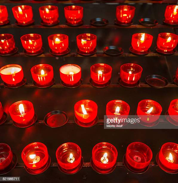 Burning votive candles in a church, Munich, Upper Bavaria, Bavaria, Germany