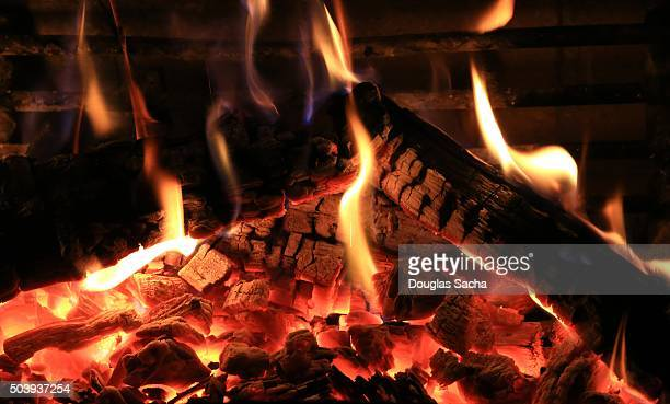 Burning wood in a cozy fireplace