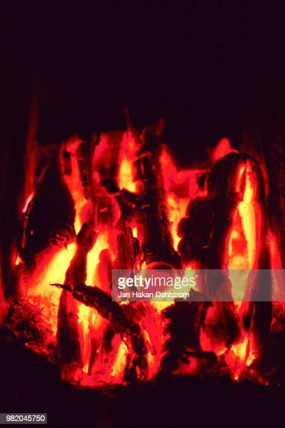 burning wood in fireplace - 暖炉の火 ストックフォトと画像