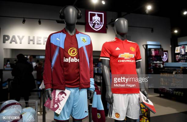 Burnley and Manchester United kits are seen in the club shop prior to the Premier League match between Burnley and Manchester United at Turf Moor on...