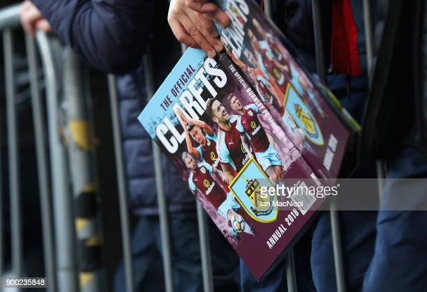 Burnley book is seen in the hands of a Burnley fan prior to the Premier League match between Burnley and Liverpool at Turf Moor on January 1 2018 in...