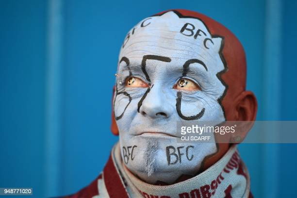 Burnley fan John Withington awaits kick off in the English Premier League football match between Burnley and Chelsea at Turf Moor in Burnley north...