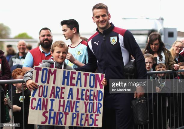 Burnley fan poses with his sign and Thomas Heaton of Burnley prior to the Premier League match between Burnley and West Ham United at Turf Moor on...