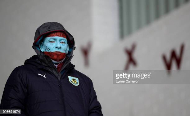 Burnley fan shows off their face paint as they look on prior to the Premier League match between Burnley and Everton at Turf Moor on March 3 2018 in...