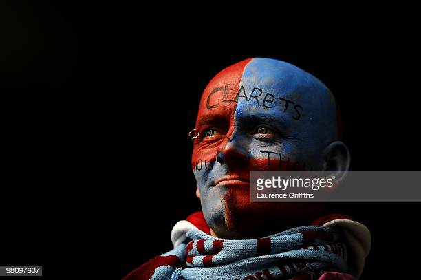 Burnley fan wears face paint during the Barclays Premier League match between Burnley and Blackburn Rovers at Turf Moor on March 28 2010 in Burnley...