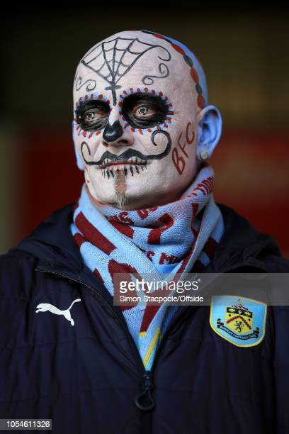 Burnley fan with a painted face for Halloween seen during the Premier League match between Burnley and Chelsea at Turf Moor on October 28 2018 in...