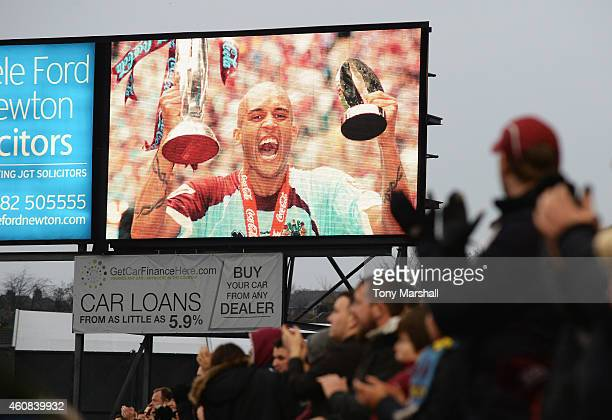 Burnley fans applaud for a minute for former Burnley player Clarke Carlisle during the Barclays Premier League match between Burnley and Liverpool at...
