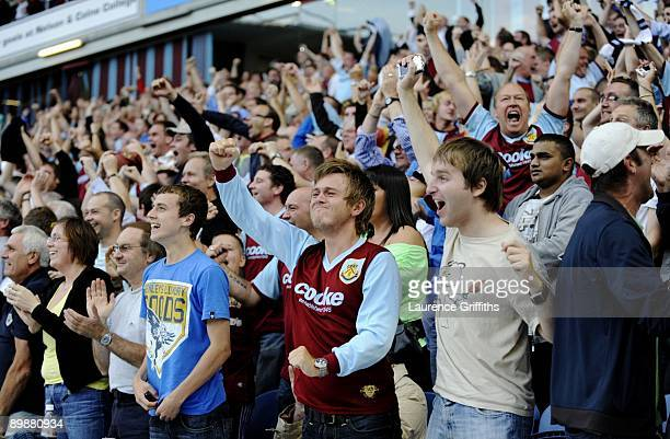 Burnley fans celebrate a goal during the Barclays Premier League match between Burnley and Manchester United at Turf Moor on August 19 2009 in...