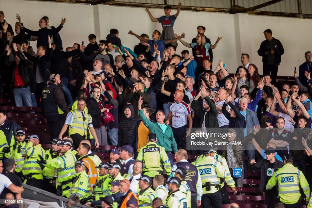 Burnley fans retaliate to the Hannover 96 fans during the Pre-Season Friendly between Burnley and Hannover 96 at Turf Moor on August 5, 2017 in Burnley, England.