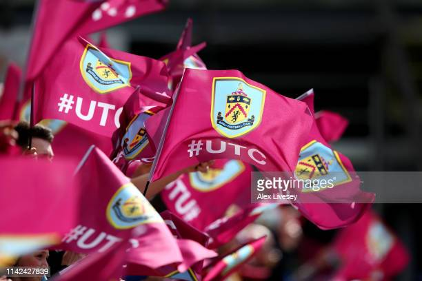 Burnley fans wave flags prior to the Premier League match between Burnley FC and Cardiff City at Turf Moor on April 13, 2019 in Burnley, United...