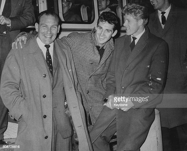 Burnley Football Club manager Harry Potts sharing a joke with players Walter Joyce and Brian Pilkington on their way to a match at London Airport...