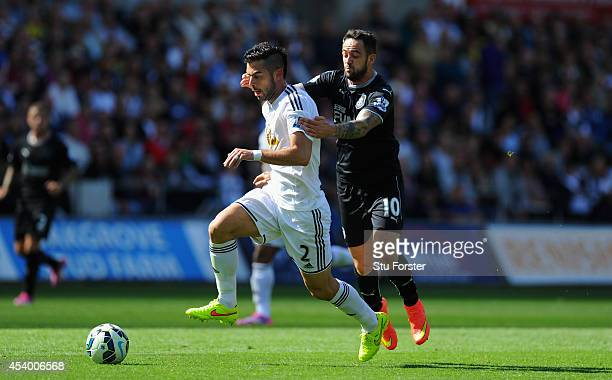 Burnley forward Danny Ings challenges Swansea player Jordi Amat during the Barclays Premier League match between Swansea City and Burnley at Liberty...