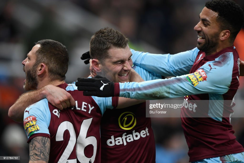Burnley forward Sam Vokes (c) celebrates his goal with David Bardsley (l) and Aaron Lennon during the Premier League match between Newcastle United and Burnley at St. James Park on January 31, 2018 in Newcastle upon Tyne, England.
