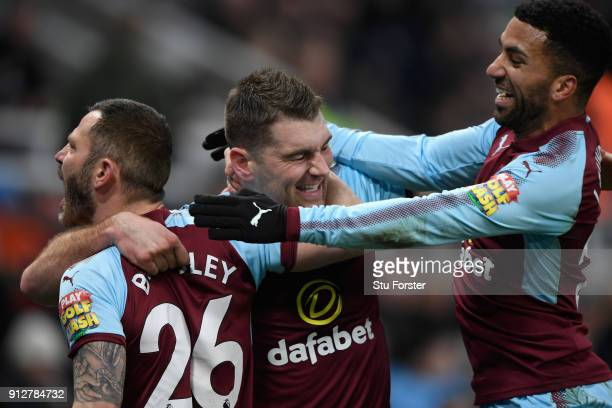 Burnley forward Sam Vokes celebrates his goal with David Bardsley and Aaron Lennon during the Premier League match between Newcastle United and...