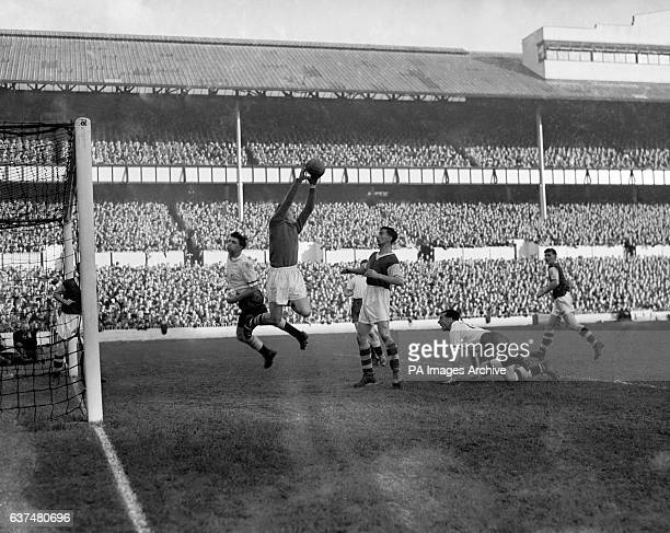 Burnley goalkeeper Colin McDonald saves from Tottenham Hotspur's Robert Smith watched by Burnley's Jimmy Adamson and Tottenham Hotspur's George Robb