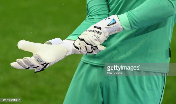 Burnley goalkeeper Nick Pope adjusts his goalkeeping gloves during the Premier League match between Newcastle United and Burnley at St James Park on...