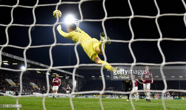 Burnley goalkeeper Nick Pope dives in vain as a shot from City striker Gabriel Jesus gives City their first goal during the Premier League match...
