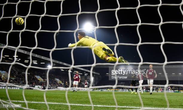 Burnley goalkeeper Nick Pope dives in vain as a shot from Gabriel Jesus gives City their first goal during the Premier League match between Burnley...