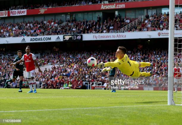 Burnley goalkeeper Nick Pope dives to amke a save during the Premier League match between Arsenal FC and Burnley FC at Emirates Stadium on August 17...