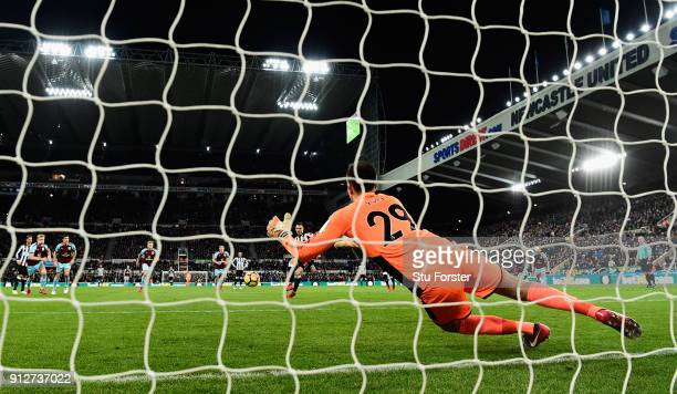 Burnley goalkeeper Nick Pope dives to save the penalty by Newcastle player Joselu during the Premier League match between Newcastle United and...