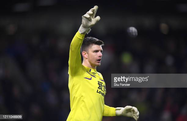 Burnley goalkeeper Nick Pope in action during the Premier League match between Burnley FC and Tottenham Hotspur at Turf Moor on March 07 2020 in...
