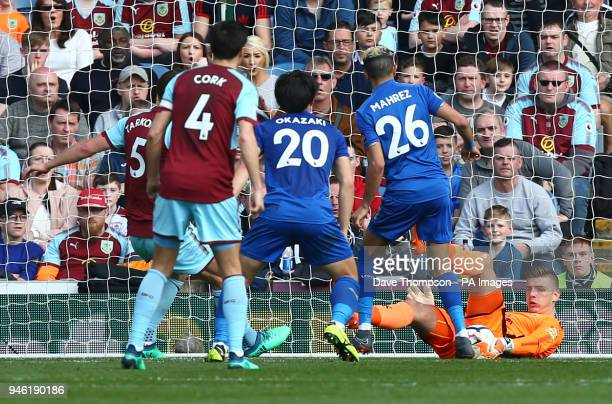 Burnley goalkeeper Nick Pope makes a save from Leicester City's Riyad Mahrez during the Premier League match at Turf Moor Burnley