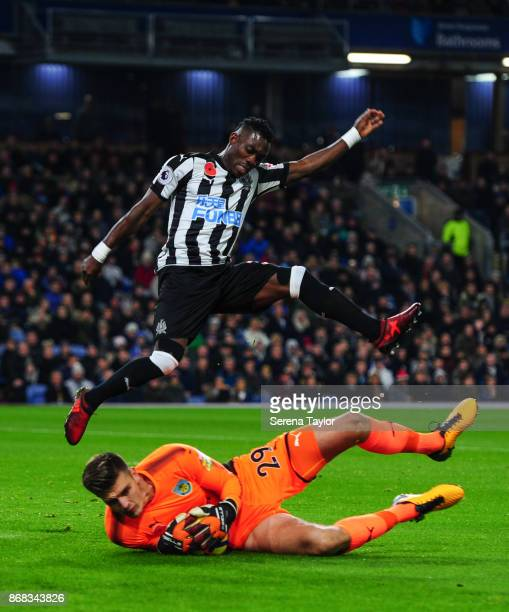 Burnley Goalkeeper Nick Pope makes a sliding save from a challenging Christian Atsu of Newcastle United during the Premier League match between...