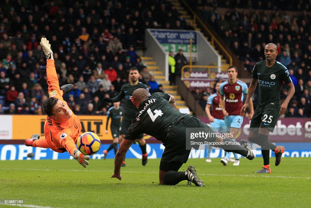 Burnley goalkeeper Nick Pope saves from Vincent Kompany of Man City during the Premier League match between Burnley and Manchester City at Turf Moor on February 3, 2018 in Burnley, England.