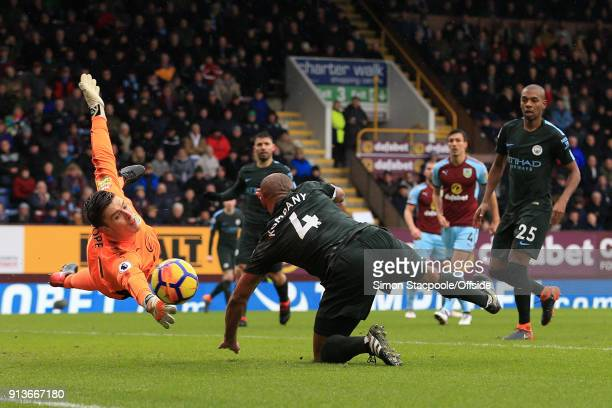 Burnley goalkeeper Nick Pope saves from Vincent Kompany of Man City during the Premier League match between Burnley and Manchester City at Turf Moor...