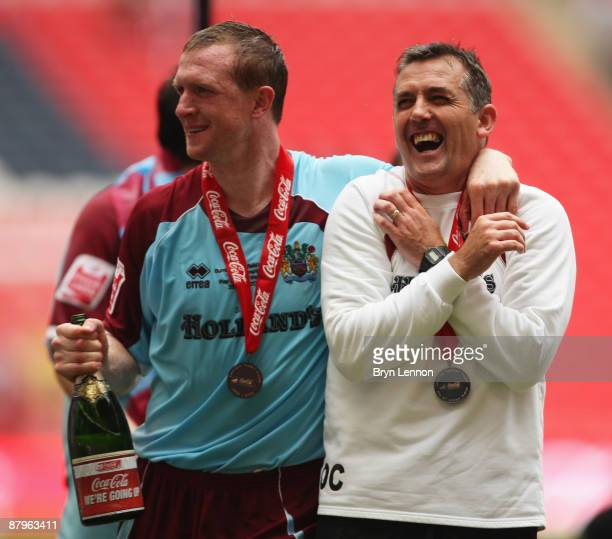 Burnley Manager Owen Coyle celebrates victory with Steven Caldwell during the CocaCola Championship Playoff Final between Burnley and Sheffield...
