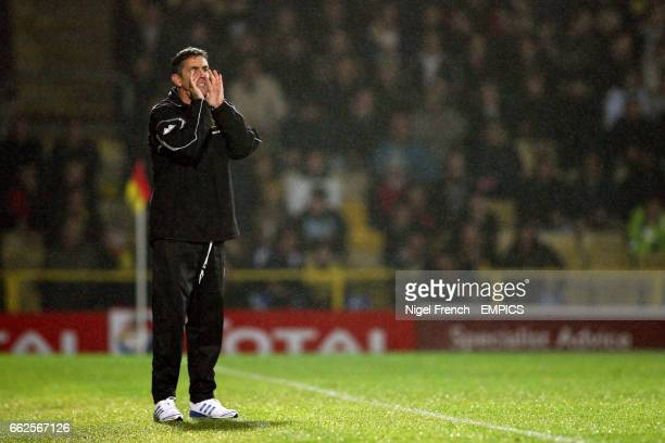 Burnley manager Owen Coyle gestures on the touchline