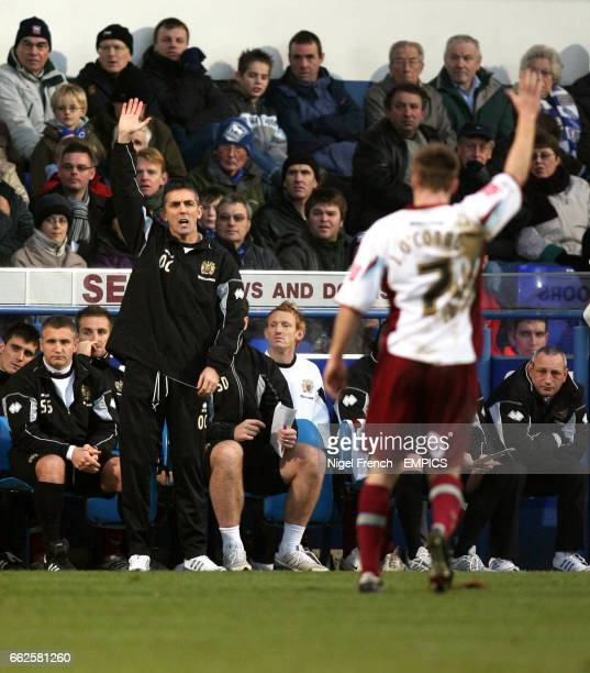 Burnley manager Owen Coyle gives out intructions to his team from the touchline