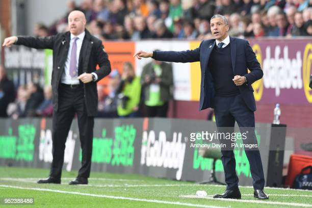Burnley manager Sean Dyche and Brighton and Hove Albion manager Chris Hughton during the Premier League match at Turf Moor Burnley