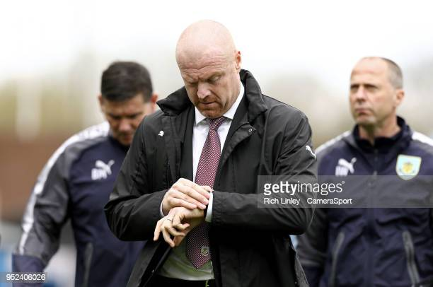 Burnley manager Sean Dyche checks his watch during the Premier League match between Burnley and Brighton and Hove Albion at Turf Moor on April 28...