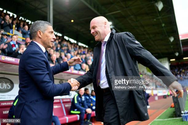 Burnley manager Sean Dyche greets Brighton Hove Albion manager Chris Hughton during the Premier League match at Turf Moor Burnley