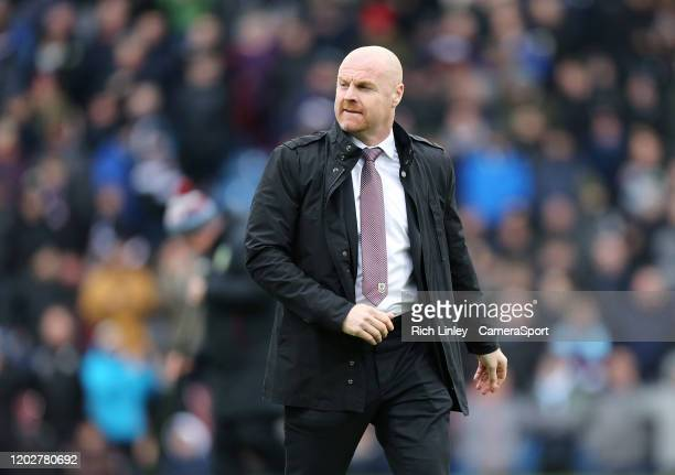 Burnley manager Sean Dyche makes his way to the dugout with his coaching staff during the Premier League match between Burnley FC and AFC Bournemouth...