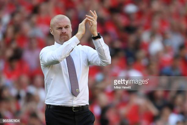Burnley manager Sean Dyche salutes the Burnley fans after the Premier League match between Arsenal and Burnley at Emirates Stadium on May 6 2018 in...
