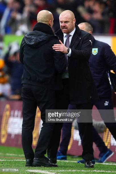 Burnley manager Sean Dyche shakes hands with Manchester City manager Josep Guardiola following the Premier League match between Burnley and...