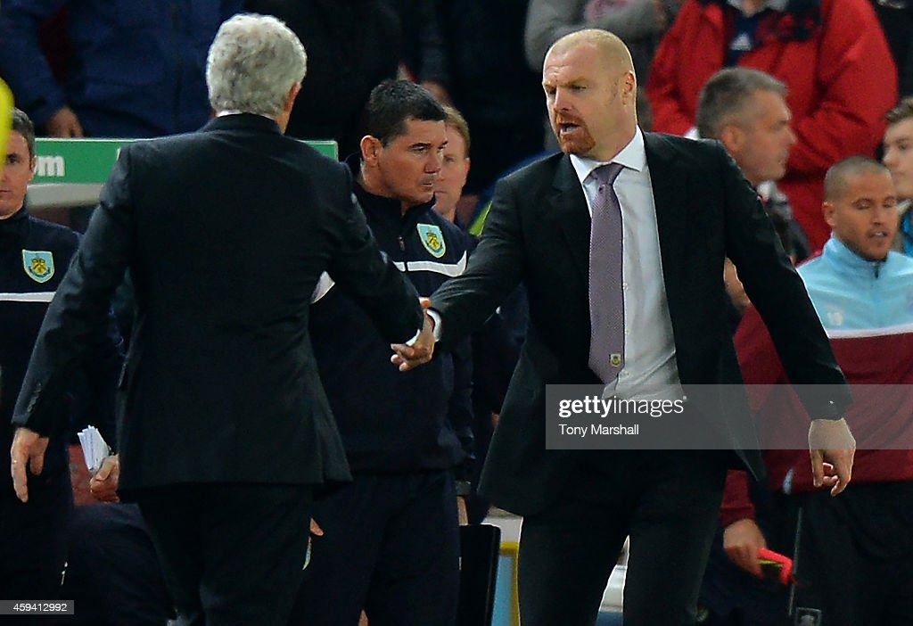 Burnley Manager Sean Dyche shakes hands with Stoke City Manager Mark Hughes (L) at the end of the Barclays Premier League match between Stoke City and Burnley at the Britannia Stadium on November 22, 2014 in Stoke on Trent, England.