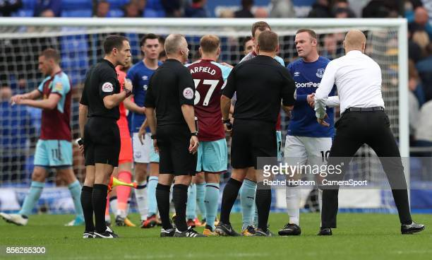Burnley Manager Sean Dyche shakes Wayne Rooneys hand at the end of the gameduring the Premier League match between Everton and Burnley at Goodison...