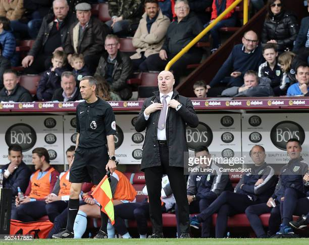 Burnley manager Sean Dyche shouts instructions to his team from his technical area during the Premier League match between Burnley and Brighton and...