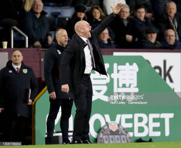 Burnley manager Sean Dyche shouts instructions to his team from the technical area during the Premier League match between Burnley FC and Tottenham...