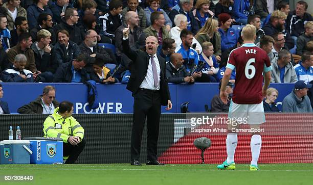 Burnley manager Sean Dyche shouts instructions to his team from the dugout during the Premier League match between Leicester City and Burnley at The...