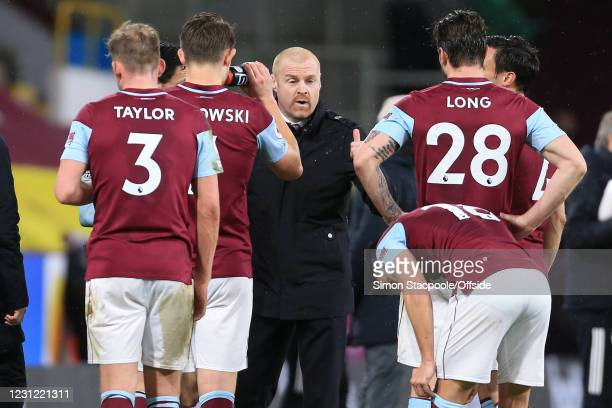 Burnley manager Sean Dyche speaks with his team during a break in play during the Premier League match between Burnley and Fulham at Turf Moor on...