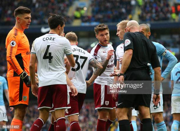 Burnley players appeal to referee Roger East as he awards a penalty to Manchester City during the Premier League match between Manchester City and...
