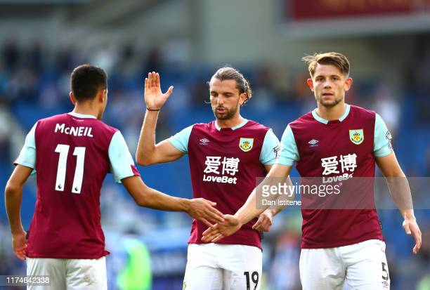 Burnley players celebrate following the Premier League match between Brighton & Hove Albion and Burnley FC at American Express Community Stadium on...