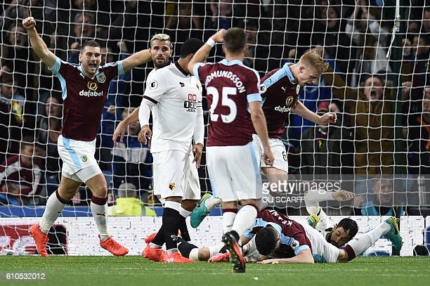 Burnley players celebrate their second goal scored by Burnley's English defender Michael Keane during the English Premier League football match...