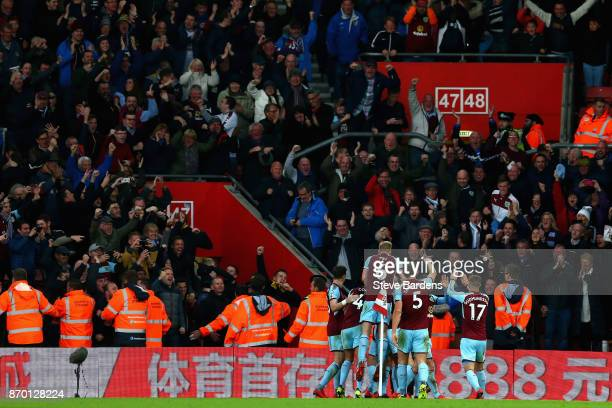 Burnley players celebrate their side's first goal with fans during the Premier League match between Southampton and Burnley at St Mary's Stadium on...